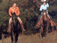 Ronald and Nancy Reagan riding horses