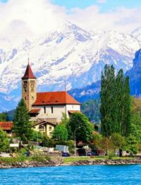 A Church By The Lake in the Alps -- Switzerland...