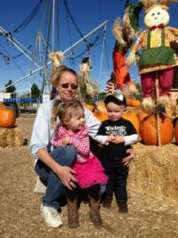 Grandchildren with pumpkins