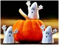 Cute Halloween Ghosts Guarding their Pumpkin