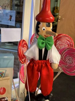 Pinnochio Puppet in Candy Cart