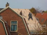 Putting up a new roofing on an old house......  (2)