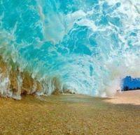Underneath a big sea wave