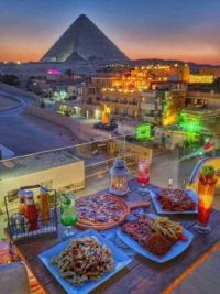 Meal with the Sunset and the view of the  pyramids, Cairo, Egypt  5813
