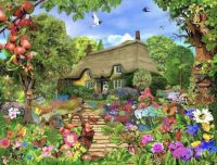 Cute Thatch cottage, and beautiful flowers!