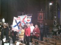 Arleen and Tom with St. Anne's Banner at Cathedral of St. John the Divine