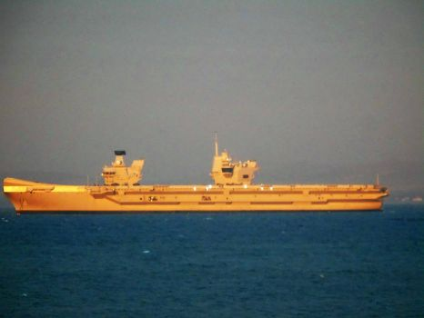 Aircraft Carrier HMS Queen Elizabeth basking in the evening sun.