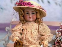Adorable Victorian Doll Wearing A Lovely Straw Hat Adorned With Pink Flowers
