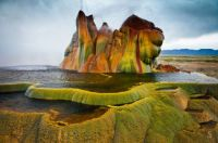 Fly Geyser is a small geyser in Washoe County, Nevada, which gives the impression of a brown ooze greenish color