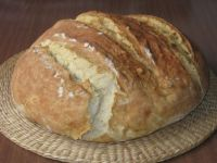 Round loaf of home-baked bread out of the oven