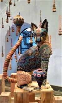 Carved Cat with Suspended Molinillos