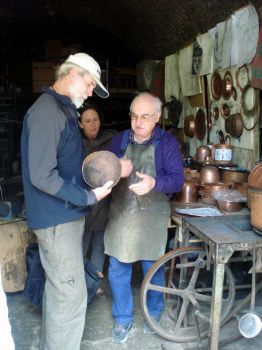 Blake holding single piece of copper which produces the pots and pans seen here.