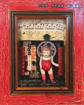 A Little Vintage Celluloid Red Haired Doll In A Red Shadow Box Frame