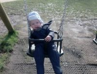 Mason's first go on a swing