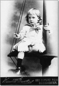 Young Boy In A Sailor Dress