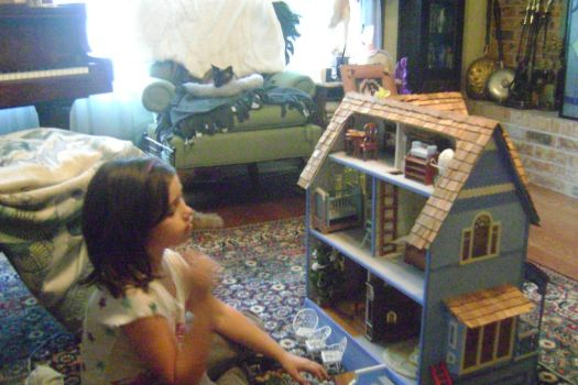 Emma Playing with her Granny's Dollhouse