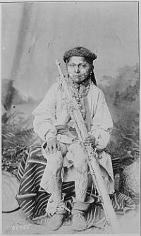 Apache boy with face and legs painted