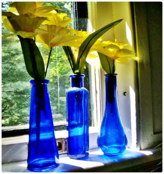 Blue Glass Vases with Yellow Flowers