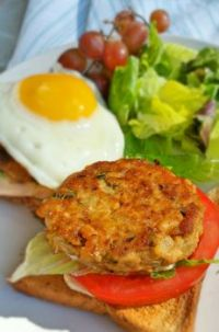 Salmon patty with fried egg and salad