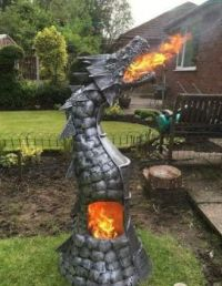 EVERYONE SHOULD HAVE A FIRE BREATHING DRAGON IN THEIR YARD!
