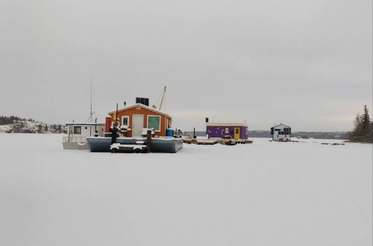 Houseboats frozen solid in the winter ice