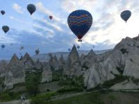 Admiring the rock formations in Cappadocia from a balloon