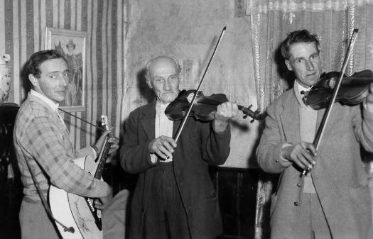 Uncle Joe, Grandad and Uncle Jack entertaining in 1950s