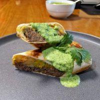 California-style burrito with barbacoa beef, jalapeño crema, fries, guacamole and cheddar
