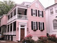 Charleston house painted pink with red roses