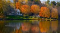 Colonial home on the water in Fall