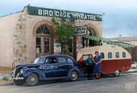 1938 Ford DeLuxe 4-door sedan towing a 1939 Masonite Airstream at the Birdcage Theater in Tombstone, Arizona.