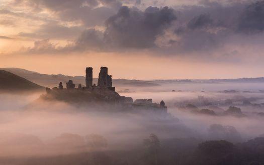 Mist rising around Corfe Castle Dorset