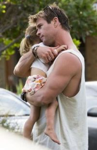 The second shot of Hemsworth with his daughter