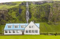 iceland house & waterfall