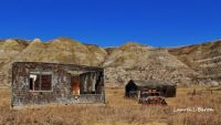 Beautiful old homestead with background of the Badlands & blue skies  Brooks Ab.