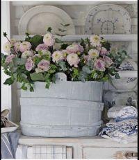 Blue bucket of flowers