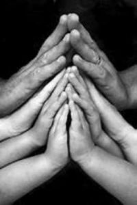 Many hands in Prayer