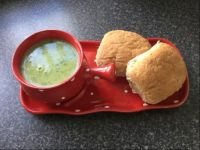 Red bowl, green soup, brown rolls