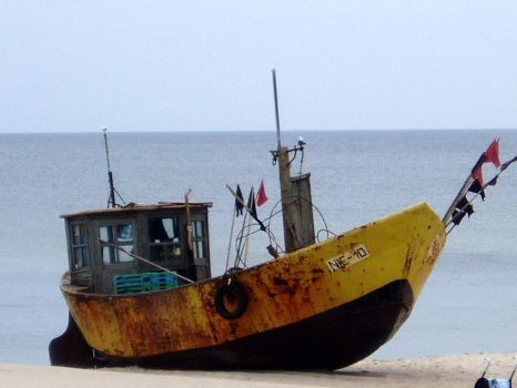 An old fishing boat at a Baltic beach