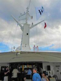 Raising flags atop the ship, 2015 trip