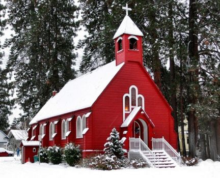 crimson church against the white snow and dark woods