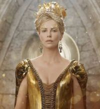 Gold 1: Charlize Theron is mad, bad and covered in glitter