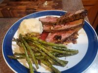 London Broil with a baked onion, mash, and asparagus