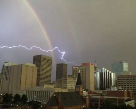 Lightning and rainbows over Oklahoma City by handsomebeans