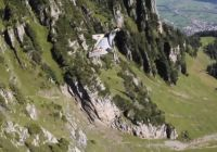 Wingsuit beside cliff