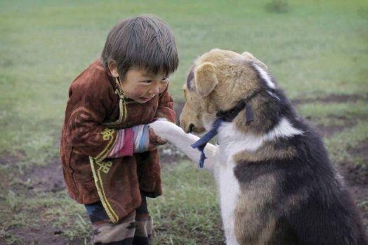 Tibetan child with dog