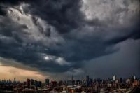 THE CITY UNDER STORM CLOUDS