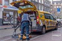 Amsterdam, Haarlemmerdijk, bicycle repair man