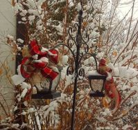 A couple of Christmas Lanterns after a snowfall.