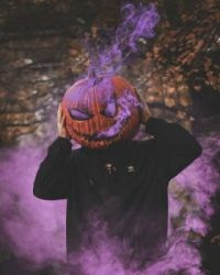 Have a purple pumpkin head Halloween